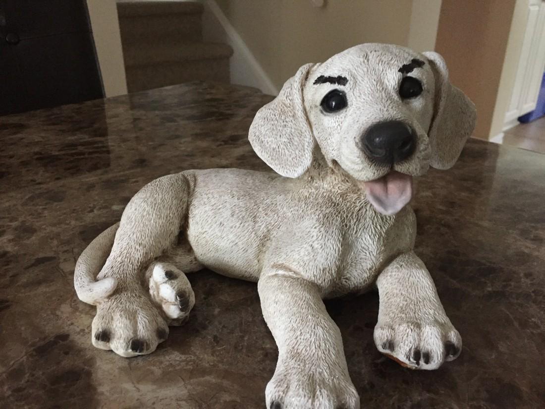 Creepy puppy statue